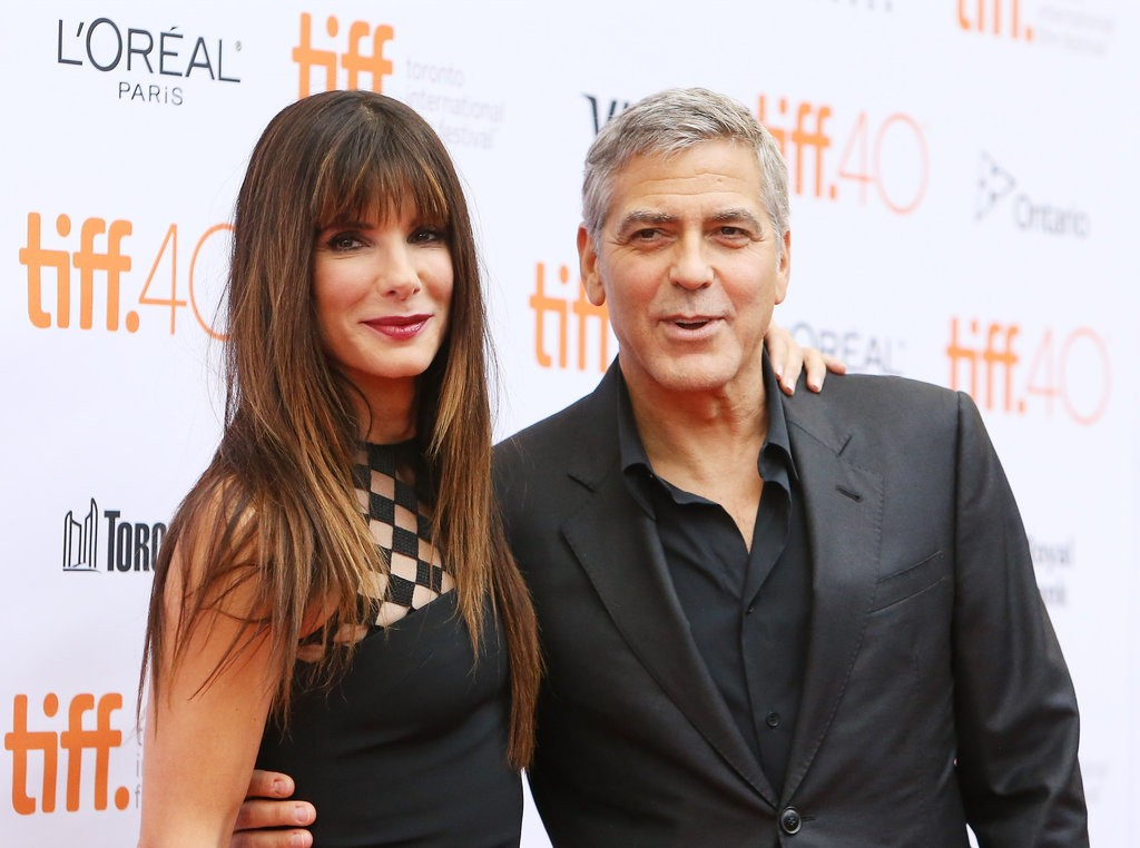 Sandra Bullock and George Clooney at TIFF15 (© Michael Tran/Getty)
